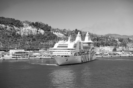Barcelona, Spain - March 30, 2016: ocean liner GNV Rhapsody Genova in sea harbor at mountains. Cruise destination and liner trip. Summer vacation on liner. travelling discovery by sea liner. Imagens