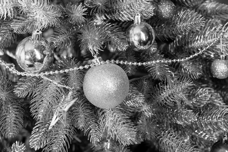 xmas and new year. Christmas tree with fir needles on golden background. Festive decorations and ornaments. Fairy lights, balls, stars, garlands on branches. Holiday celebration concept. Standard-Bild - 120907905
