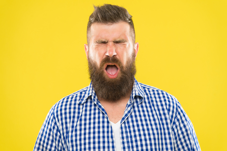 Man bearded hipster with sneezing face closed eyes close up yellow background. Brutal hipster sneezing. Allergy concept. Take allergy medications. Can not stop sneezing. I am going to sneeze. Standard-Bild - 120907951