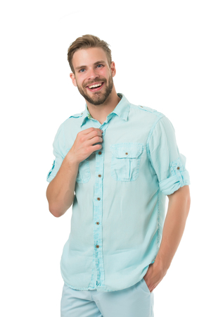 It is hot here. Man handsome bearded guy smiling on white background isolated. Guy cheerful smile macho feels hot while unbuttoning shirt. Positive emotions. Brilliant smile. Man with sincere smile. Standard-Bild - 120907961