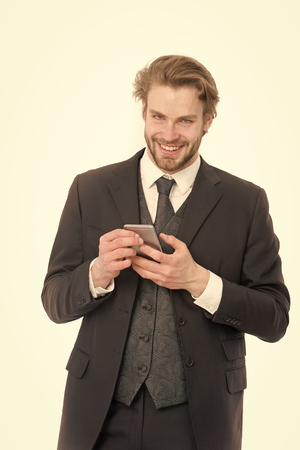 Conversation and new technology. Manager with beard on smiling face. Businessman or ceo in black jacket. Business fashion and success. Man in formal outfit with mobile phone. Standard-Bild - 120907967