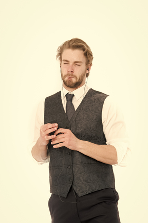 Manager with beard on sad face. Man in formal outfit with mobile phone. Headset and mp3. Businessman or ceo listen music. Fashion and new technology. Standard-Bild - 120907984