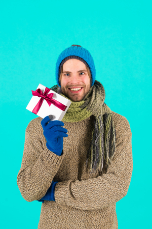 Ready to make her happy. Man bearded handsome wear winter hat scarf gloves hold gift box. Hipster hold christmas gift with bow. Holiday present concept. Winter holidays. Give gift spread happiness. Standard-Bild - 120907998