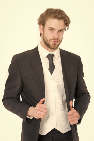 businessman in black formal outfit with serious face isolated on white Standard-Bild - 120907999