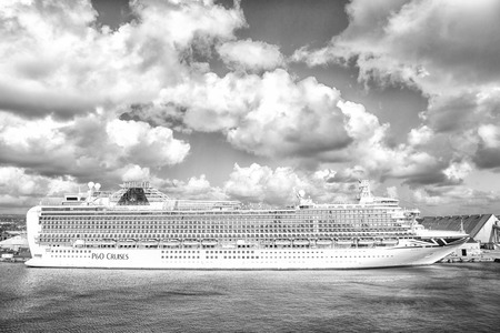 Bridgetown, Barbados - December 12, 2015: P O Cruises. Azura cruise ship docked in sea port on cloudy sky. Transportation. Travelling by sea. Recreation and summer vacation. Standard-Bild - 120908012