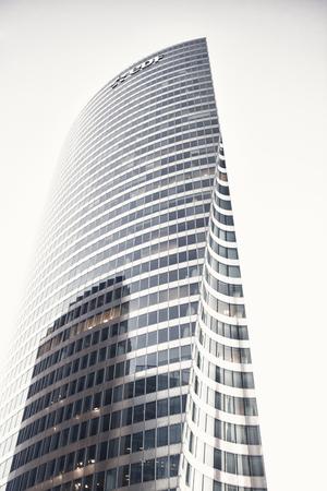 La Defense, Paris - September 20, 2017: skyscraper glass facade on blue sky background. Architecture, structure, design. Business commerce finance Success future concept