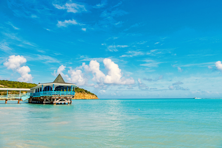 Sea beach with wooden shelter on sunny day in antigua. Stock Photo
