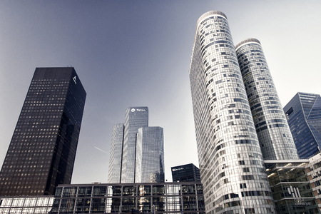 La Defense, Paris - September 20, 2017: skyscraper buildings on sunny day on blue sky background. Business, commerce, finance. Architecture, structure design Success future concept