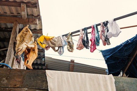 Laundry and fish drying in air on white sky in boca de valeria, brazil. Washing and fishing.