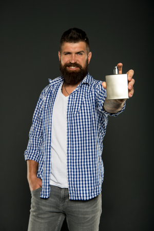 Bearded man. Male fashion. man presenting perfume product. aroma and smell. brutal caucasian hipster with moustache. Facial care. Mature hipster with beard. Making hair look magical.