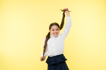 Smart school girl. childrens day. Back to school. Childhood happiness. small girl child. private teaching. Education online. happy little girl in school uniform. Happy graduation. Stock Photo