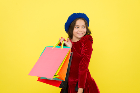 Happy shopping online. small girl child with shopping bags. big sale in shopping mall. Birthday and christmas presents. International childrens day. Taking two. Perfect day. Stockfoto