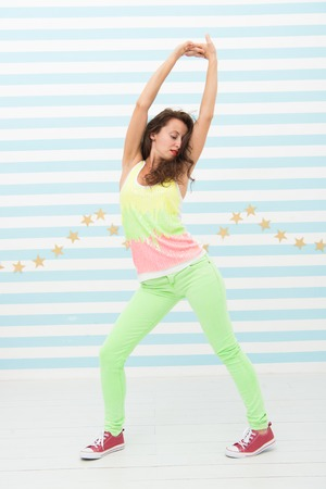 Glamour fashion model. Crazy girl in colorful sporty clothes. Happy and stylish sexy woman. Hip hop woman dancer. Fashion and beauty. Hipster girl. Add some action to your life.
