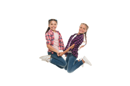 Sisterhood goals. Sisters together isolated white background. Sisterly relationship. Sisterhood is unconditional love. Girls playful sisters having fun jumping. Fun joy and celebrate. Active leisure.