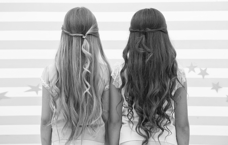 Girls children long curly hair rear view. Treat hair proper way according type. Apply conditioner mask after washing and spray oil before styling curls. Hairstylist tips. Easy hairstyles every day.
