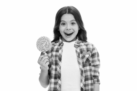Can sugar make us happy. Girl cute smiling face holds sweet lollipop. Sweets in appropriate portions ok. Girl likes sweets as lollipop candy isolated white background. Control nutrition of your child.