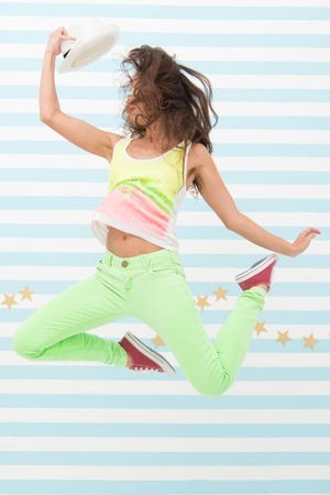Hip hop woman dancer. Crazy girl in colorful sporty clothes. Happy and stylish woman. Glamour fashion model. Fashion and beauty. Hipster girl. extremely happy. jumping girl.