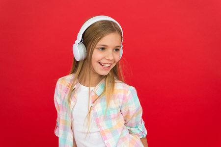 Online radio station channel. Girl child listen music modern headphones. Get music account subscription. Enjoy music concept. Music always with me. Leisure concept. Little girl listen song headphones.