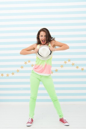 Crazy girl in colorful sporty clothes. Stylish and confident. Hip hop woman dancer. Happy and stylish sexy woman. Glamour fashion model. Fashion and beauty. Hipster girl.