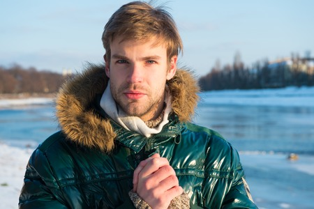 Sexy man in warm clothes. Warm clothes for cold season. Man traveling in winter, nature. Winter fashion. Green warm coat. Happy winter holidays. Flu and cold. Winter flu. It is so cold.