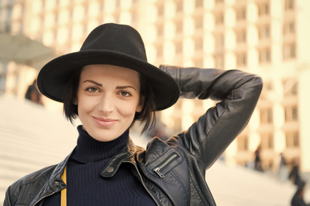 Fashion, accessory, style. Sensual woman with brunette hair, hairstyle. Beauty, look, makeup. Skincare, youth, visage Woman in black hat smile on stairs in paris france fashion Stock Photo