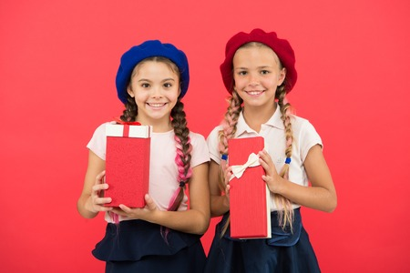 Kids girls hold birthday gifts boxes. Dreams come true. Happy childhood. Shopping concept. Child cute small girls on shopping tour. Pick gift for yourself. Get bonus. Extra bonus gift. Birthday gift. 版權商用圖片
