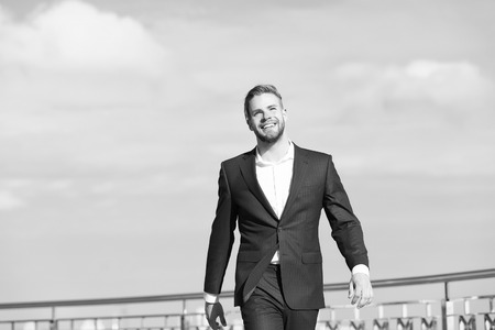 Success his second name. Businessman successful entrepreneur in suit walks outdoor sunny day sky background. Man confident and well groomed enjoy freedom. Luck and success concept. Feel superior.
