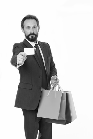 Ask deliver your purchases. Businessman formal suit holds bunch paper bags while show business card. Man bearded businessman use delivery service. Businessman hold plastic blank card copy space.