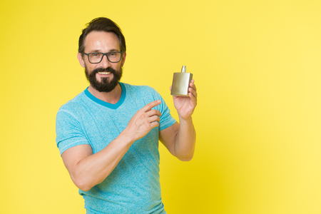 Man bearded handsome hold bottle perfume. How choose perfume for men according to occasion. Make sure smell fresh throughout day. Wearing perfume is enhancing mood. Amazing benefits of using perfumes.