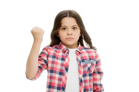Punch you in your face. Stop bullying movement. Girl threatening with fist. Threatening physical attack. Kids aggression concept. Aggressive girl threatening to beat. Serious child threatening.