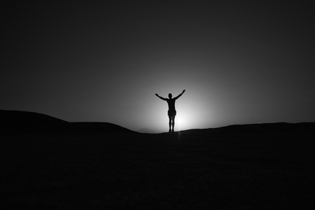 Achieve main goal. Silhouette man stand proud in front of sunset sky background. Future success depends on your efforts now. Daily motivation. Healthy lifestyle personal achievement goal and success. Stock Photo
