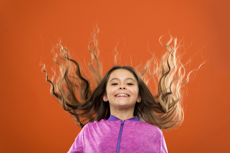 Small girl child. Hairdresser for kids. childrens day. Portrait of happy little child. Kid fashion and sportswear. childhood happiness. Family. Happy little girl with long hair. I wish.