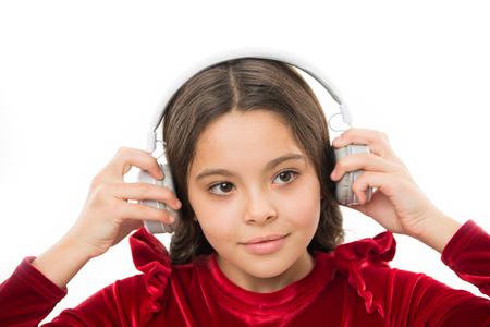 Listen for free new and upcoming popular songs right now. Little girl listen music wireless headphones. Online music channel. Girl little child use music modern headphones. Music always with me.
