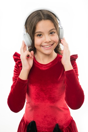 Online music channel. Girl little child use music modern headphones. Listen for free new and upcoming popular songs right now. Music always with me. Little girl listen music wireless headphones.