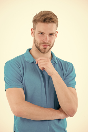 Man with beard on unshaven face skin. Bearded man in blue tshirt. Fashion model with stylish hair isolated on white background. Skincare and barber salon. Style trend and hairstyle concept. Фото со стока