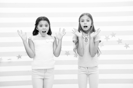 Thrilled moment from childhood. Kids schoolgirls preteens shocked. Girls surprised shocked faces thrilled expression stand striped background. Girls children best friends wonder about surprising news.
