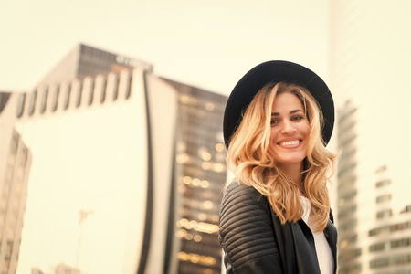 Happy woman with long blond hair, hairstyle, in paris, france. Sensual woman in black hat smile outdoor, fashion. Beauty, look, makeup. Fashion, style, accessory Youth skincare visage Stock Photo