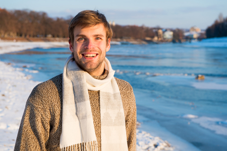 Man traveling in winter, nature. Warm clothes for cold season. Sexy man in winter clothes. Winter fashion. warm sweater and scarf. Happy winter holidays. Flu and cold. Christmas vacation. Warm smiles.