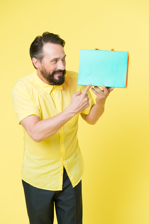 After shopping. copy space. big sale in shopping mall. Bearded man with shopping bags. Happy holidays. Mature hipster with beard. shopping. brutal caucasian hipster with moustache. Online shop. Stock Photo