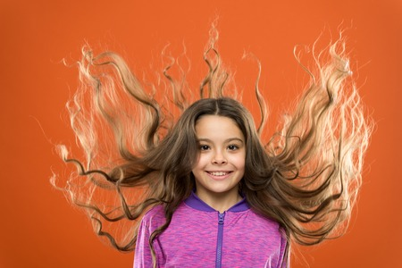 Strong and healthy hair concept. How to treat curly hair. Nice and tidy hairstyle. Easy tips making hairstyle for kids. Small child long hair. Charming beauty. Girl active kid with long gorgeous hair. Standard-Bild - 122261665