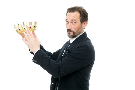 Being successful. Mature businessman holding crown. Business king. Success in business. Achieving victory and success. Senior man representing power and triumph. King of style. Fit for a king. Фото со стока
