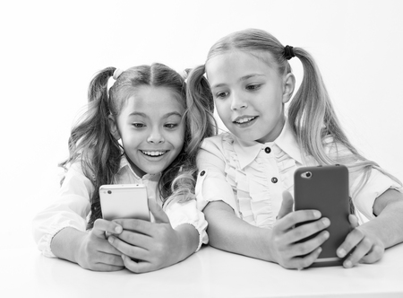 online education for digital children with happy faces. online education. happy childgren with digital devices - smartphones. we are living in digital age. Banco de Imagens