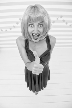 Fun and entertainment. Lady actress practicing performance. Girl posing striped background of studio. Lady red or ginger wig posing in blue dress. Comic actress concept. Woman playful mood having fun.