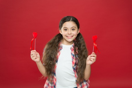 I will be your Valentine. Love and family. Childhood happiness. happy little girl. February holiday. Childrens day. Happy child with red decorative heart. Valentines day. Small girl with cute look.