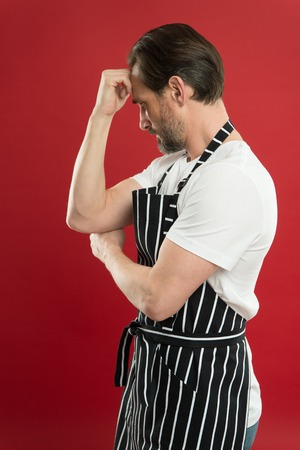 Confident mature handsome man in apron red background. He might be baker gardener chef or cleaner. Good in everything. Professional occupation. Apron for dirty work. Man in apron. Lot of work. Stok Fotoğraf - 122262517