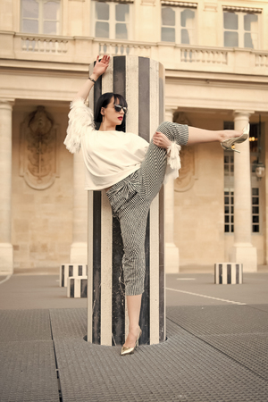 Sensual woman with brunette hair. Beauty girl with glamour look. Fashion model in sunglasses on square. Fashion and vogue. Yoga and sport concept. dance pose concept Banco de Imagens - 122262610