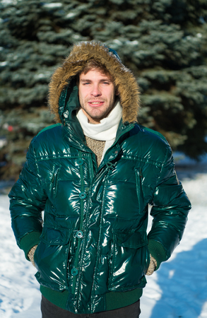 Winter fashion. Warm clothes. man on winter holidays. Snowy weather. Trendy winter coat. Vacation and traveling in winter. Man. It is cold outside. Forest in snow. Fresh air. It is so cold. Imagens