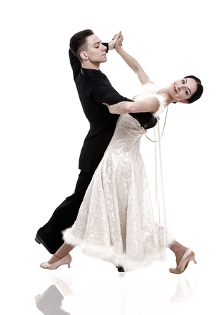 ballroom dance couple in a dance pose isolated on white background. ballroom sensual proffessional dancers dancing walz, tango