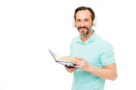 Online education. Man mature bearded guy listening online course. Get more information. Audio book. Reading and listening. Modern education concept. Benefits of online education. Access to knowledge.