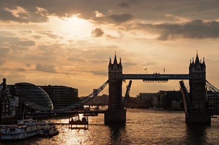 Tower bridge with skyline London, United Kingdom. Bridge over Thames river on cloudy sky. City buildings on river banks. Architecture and structure concept. Wanderlust and vacation. Reklamní fotografie